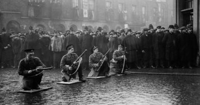 Scots Guards with rifles take position during the battle.